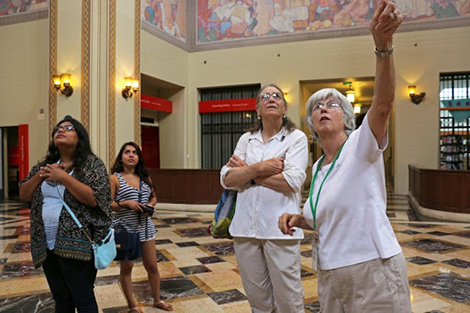 docents pointing at the library's rotunda ceiling
