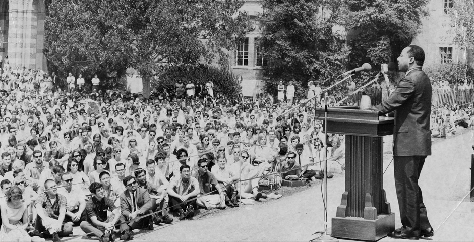 MLK at UCLA podium in front of a crowd of students
