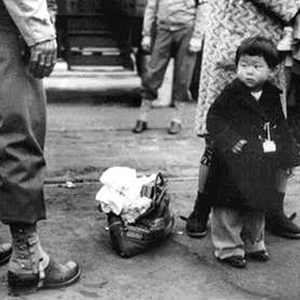 Japanese-American Child Being Evacuated with His Parents