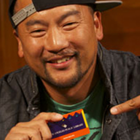 roi choy holding a library card