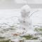 melting snowman in a field