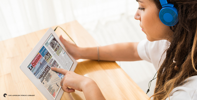 Student reading a newspaper online