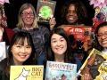 librarians holding up picture books