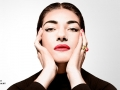 a photograph of Maria Callas wearing black looking straight into the camera