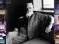 Rex Stout among his book covers