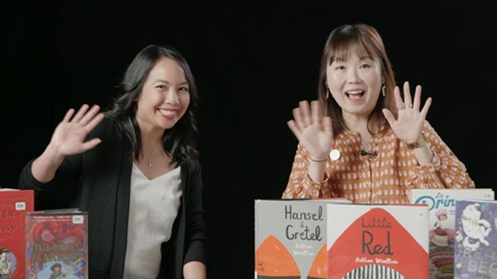 two women waving hello