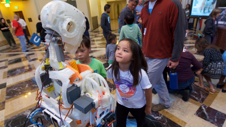 kids and robots at a stem event