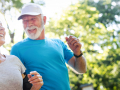 older couple smiling and jogging