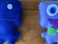 photo of two blue felt monster dolls